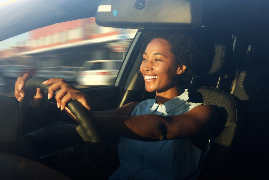 woman happy while driving