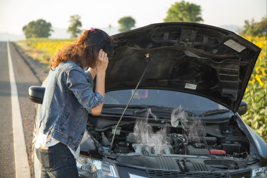 Female with a busted car engine