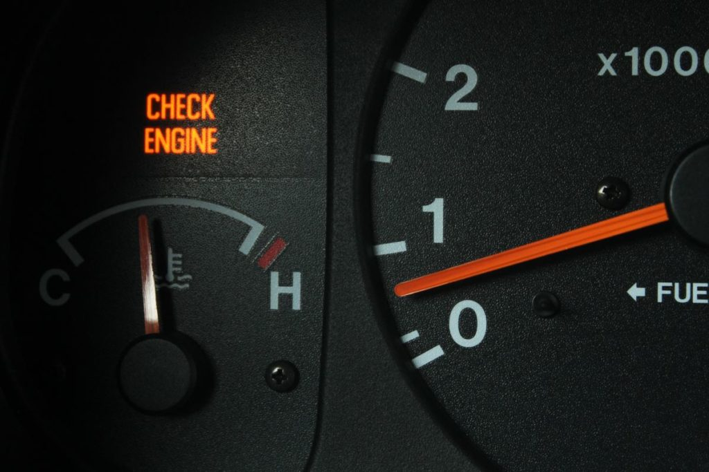check engine light on the gauge panel of a car